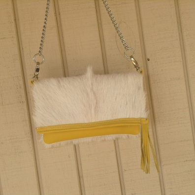 This is just too cute! Great for spring. It's white goat hide and yellow leather with interchangeable chain or leather shoulder strap.